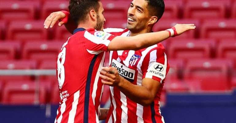 Luis Suarez celebrating with Saul Niguez