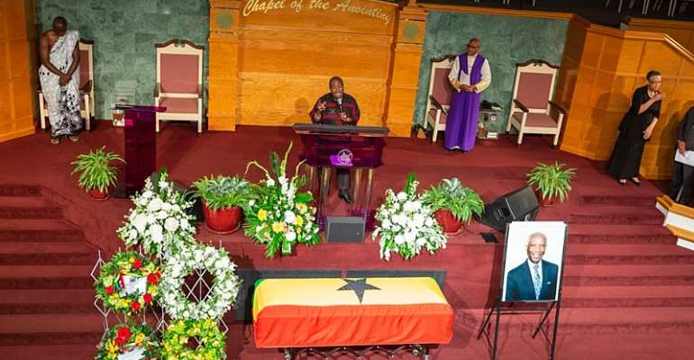 The casket draped in the national flag containing the body of Dr Botchwey at the funeral service.