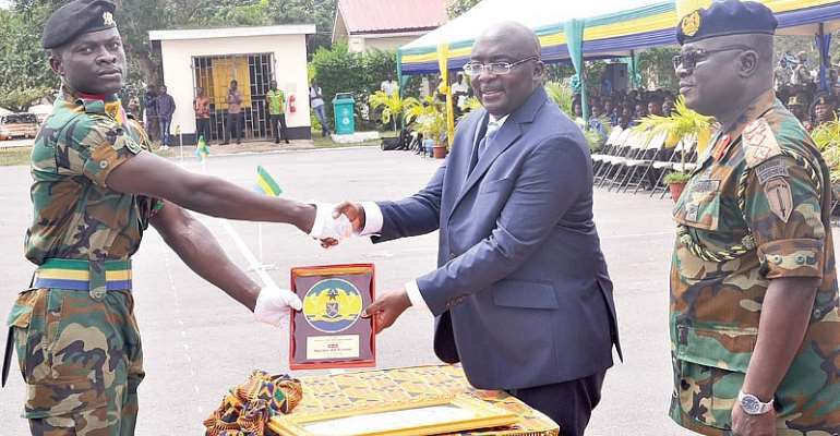Vice-President Dr Bawumia presenting a plaque to Lance Bombadier Samuel Kojo Afful for his outstanding performance. With them is Maj. Gen. William Ayamdo (right), Chief of the Army Staff