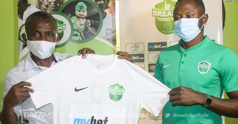 Joseph Esso (R) with Dreams FC official (L)
