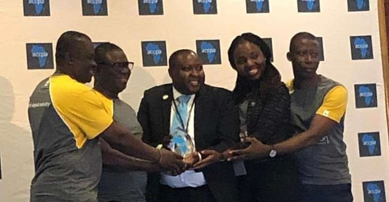 From Left Mr Kwarteng, Mr Osman, Mr Honya (President Of ACCPA Presenting The Award), Ms Opoku And Mr Asante