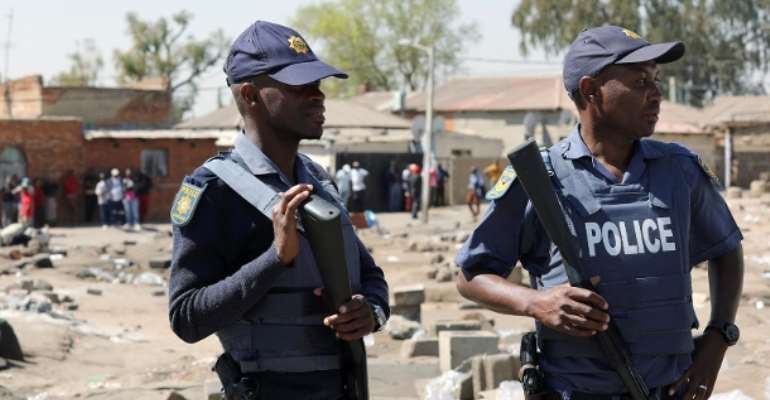 Police officers in a township of Johannesburg, many people killed in attack