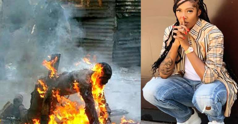 A foreigner being burnt alive in SA… Tiwa Savage