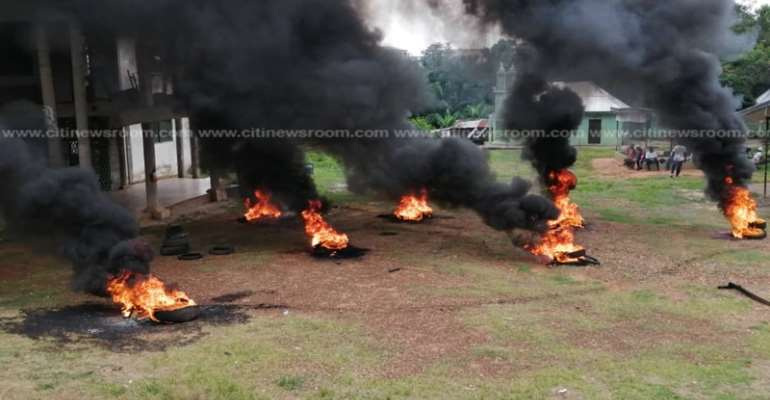 Supporters Of Disqualified Asawase Aspirant Burn Tyres At NDC Party Office