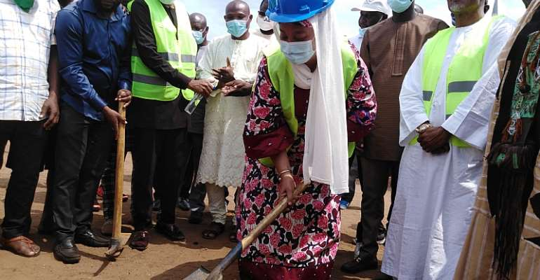 Hajia Salma, the Ayawaso East Mayor cutting sod for commencement of the project