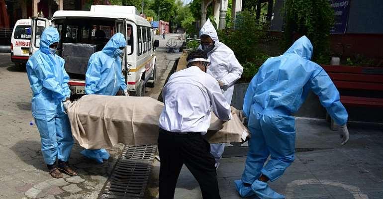 © Caption: Bodies continue to arrive in mortuary in Delhi from Covid - Credit: Jitender Gupta