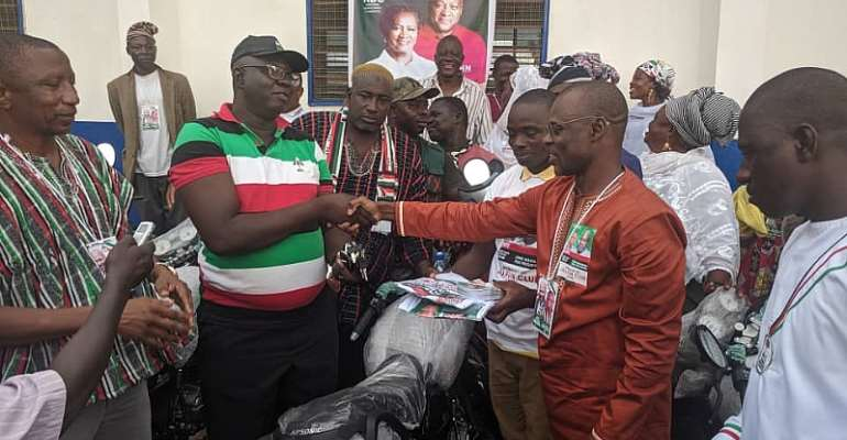 Dr Thomas Anaba presenting the motorbikes and items to the constituency executives and the incumbent MP