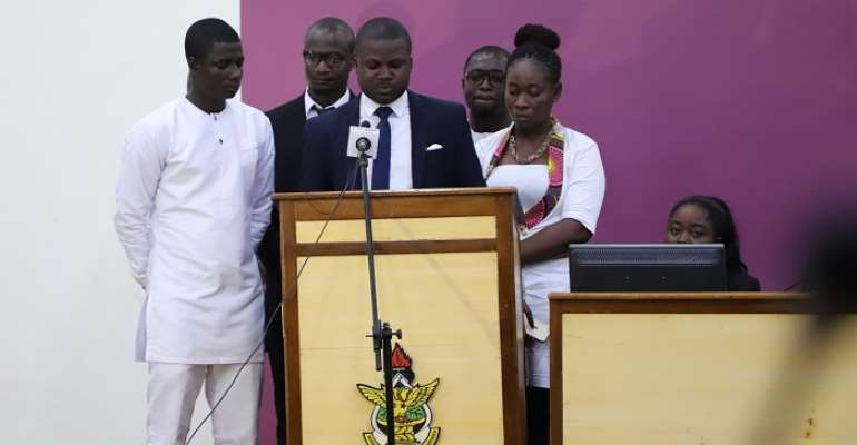 The President (Middle) flanked by the newly sworn in executive delivering his speech