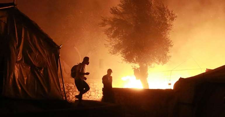 Migrant hopes go up in smoke as Greece's Moria camp burns to the ground