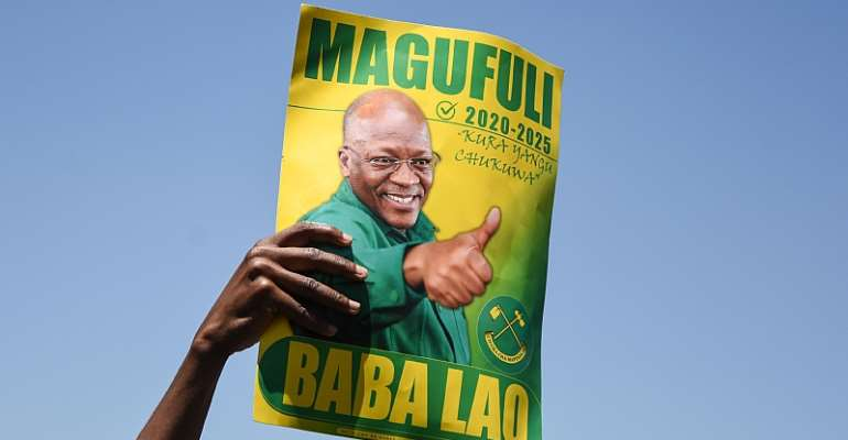 A campaign poster of John Magufuli of the ruling Chama Cha Mapinduzi party who is seeking re-election as president in October.   - Source: Ericky Boniphace/AFP via Getty Images)