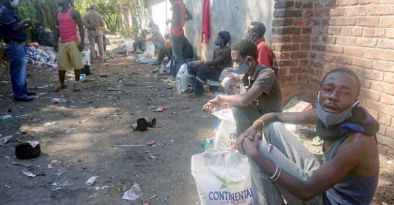 A group in the secret alleyway after a distribution of reusable masks, hand sanitiser and mealie meal. - Source: Ralph/Growing up on the Streets