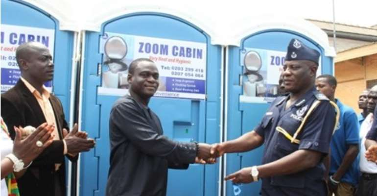 Mr. Robert Coleman presenting the mobile toilet to DCOP Christian Tetteh Yohonu.