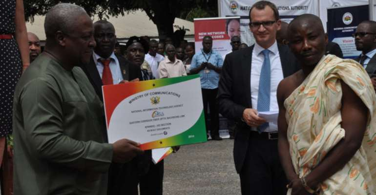 His Excellency President John Dramani Mahama receives a copy of the project document from a representative of one of district flanked by Daniel Jaeger, vice president of Alcatel-Lucent in Africa
