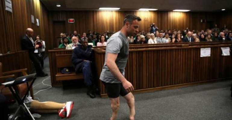 Pistorius walks on stumps to show court his disability