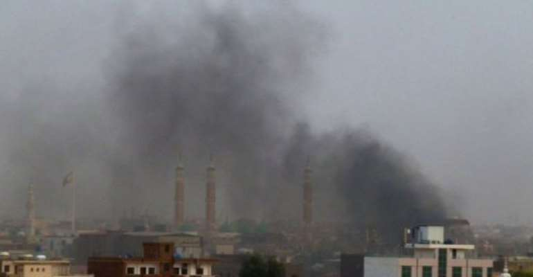 Smoke rises from burning tyres during protests in the Sudanese capital Khartoum on June 22.  By Ian Timbarlake (AFP/File)