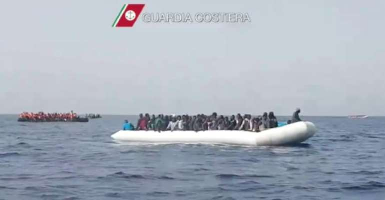 A picture released by Italian Coast Guards shows a rescue operation in May of a boat carrying migrants off the coast of Sicily.  By Str (AFP/File)