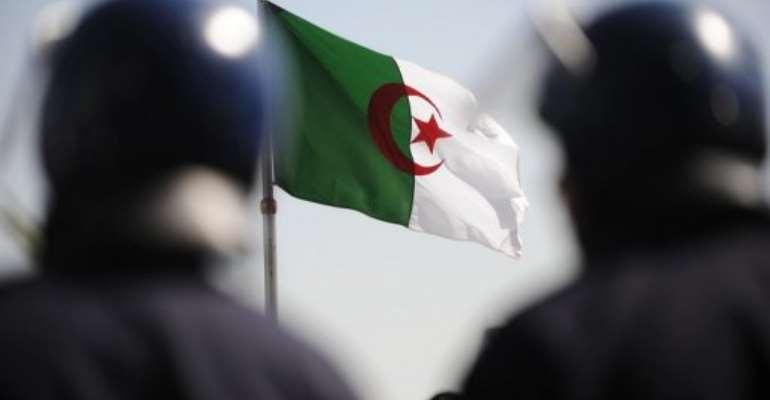 Policemen are pictured in 2011 in Algiers.  By Farouk Batiche (AFP/File)