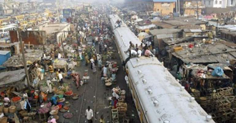 Commuters sit on coaches of a train in Lagos, Nigeria, in 2007.  By Pius Utomi Ekpei (AFP/File)