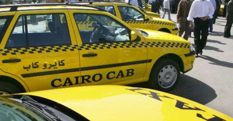 Taxi cabs aligned in one of Cairo's main squares on March 15, 2006.  By Khaled Desouki (AFP)