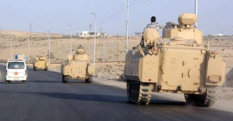 A convoy of Egyptian armoured vehicles moves along a road in El-Arish on the Sinai Peninsula on August 13, 2011.  By  (AFP/File)