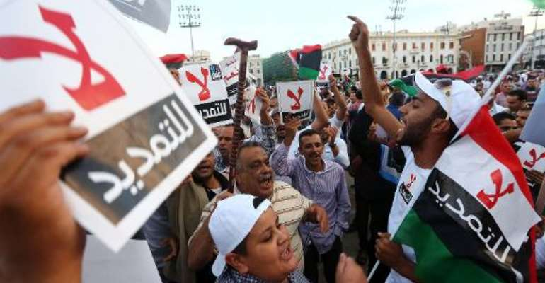 Libyans demonstrate in Tripoli's landmark Martyrs Square on November 9, 2013, to oppose a renewed mandate for the country's top political body, the General National Congress.  By Mahmud Turkia (AFP/File)