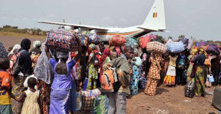 Chadian nationals and other foreign civilians, mostly Muslims, queue to board a plane bound for N'Djamena as they flee Bangui to avoid being targeted by Anti-Balaka Christian militants on January 31, 2014.  By Issouf Sanogo (AFP)