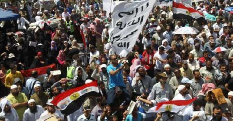 Salafist protesters in Abbassiya district were attacked by residents, MENA newsagency says.  By Khaled Desouki (AFP/File)