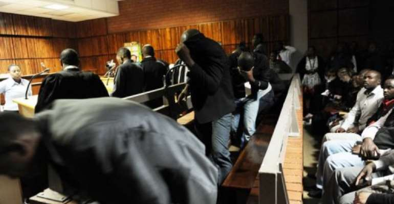 Policemen accused over the death of a taxi driver appear at Benoni Magistrate's Court in South Africa on March 11, 2013.  By Werner Beukes (Pool/AFP/File)