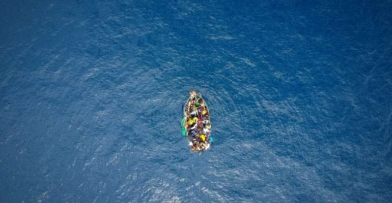 A boat in the Strait of Gibraltar carrying migrants who were rescued on September 8, 2018.  By Marcos Moreno (AFP/File)