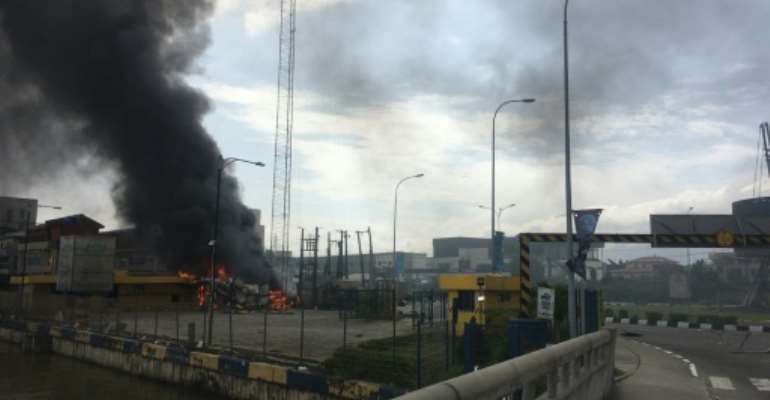 A building on fire near the Lekki-Ikoyi Toll Gate  in Lagos, the biggest city in Nigeria where protests have been going on for two weeks.  By SOPHIE BOUILLON (AFP)
