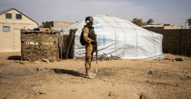 A Burkina Faso soldier patrols at a camp in Dori sheltering people displaced from northern Burkina Faso..  By OLYMPIA DE MAISMONT (AFP/File)