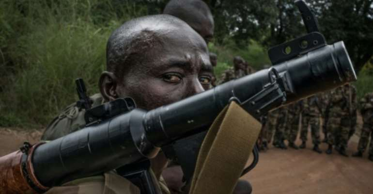 A Central African Republic soldier trains with an anti-tank weapon in August 2019.  By FLORENT VERGNES (AFP/File)
