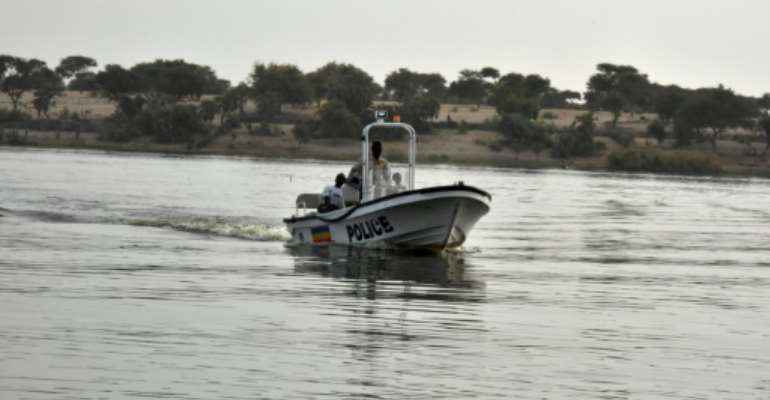 A Chadian police vessel patrols on Lake Chad near the border with Cameroon and Nigeria.  By SIA KAMBOU (AFP/File)