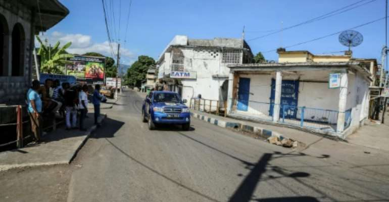 A Comoros police vehicle patrols the tense, deserted streets of Mutsamudu, where rebels oppose President Azali Assoumani's bids to extend term limits through constitutional changes.  By YOUSSOUF IBRAHIM (AFP)