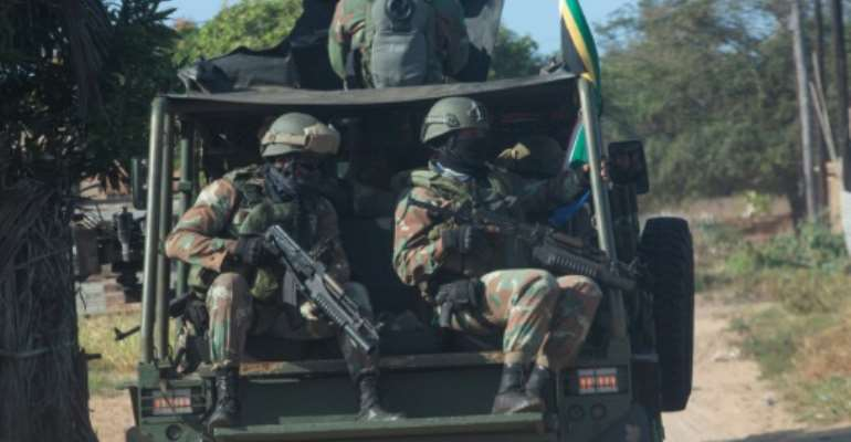 A convoy of South Africa National Defence Forces patrols the  Maringanha district in Pemba on Thursday.  By Alfredo Zuniga (AFP)