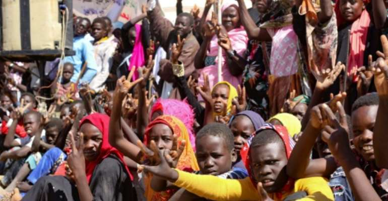A December 31 file picture shows Sudanese internally displaced people in South Darfur protesting against the end of the United Nations and African Union peacekeeping mission.  By - (AFP/File)