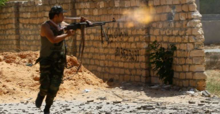 A fighter loyal to Libya's Government of National Accord opens fire on September 7, 2019 -- the UN mission has renewed its mandate and backed struggling ceasefire efforts.  By Mahmud TURKIA (AFP)