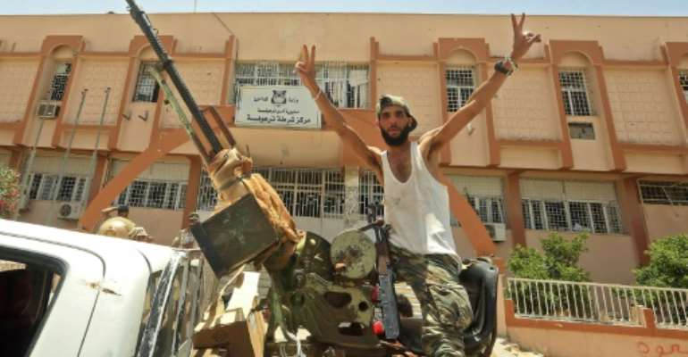 A fighter loyal to Libya's UN-recognised Government of National Accord in the recaptured town of Tarhuna on June 5.  By Mahmud TURKIA (AFP)