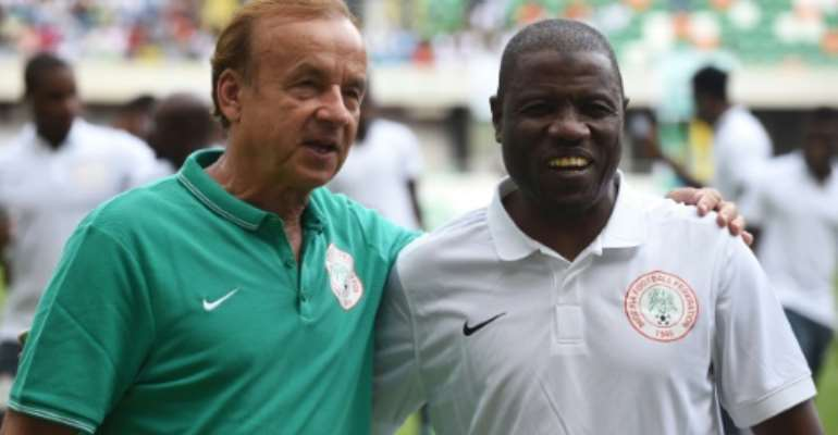 A file photo of assistant Salisu Yusuf (R) posing with Nigeria head coach Gernot Rohr.  By PIUS UTOMI EKPEI (AFP)