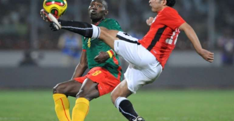 A file picture of now retired Cameroon star Geremi Njitap (L) playing against Egypt during he 2008 Africa Cup of Nations in Ghana.  By JOE KLAMAR (AFP)