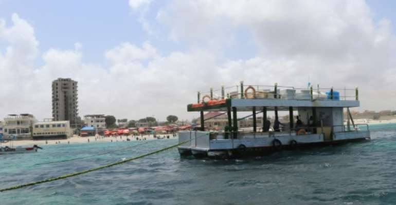 A floating restaurant off Lido beach has been a helpful distraction in Mogadishu, which is plagued by regular bombing.  By Abdirazak Hussein FARAH (AFP)