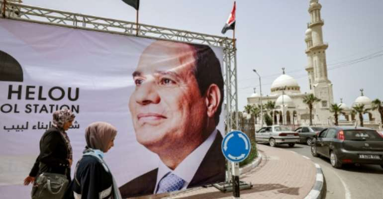 A giant banner depicting Egypt's President Abdel Fattah al-Sisi is seen on display in Gaza City on May 31, 2021.  By MOHAMMED ABED (AFP/File)
