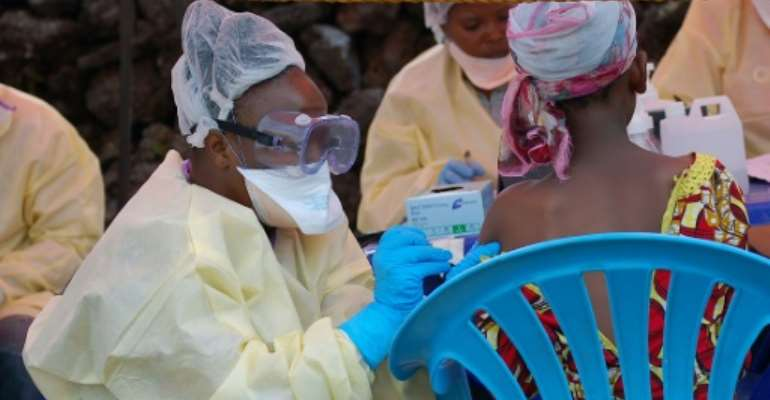 A girl receives a vaccine against Ebola from a nurse in Goma on August 7, 2019.  By Augustin WAMENYA (AFP/File)