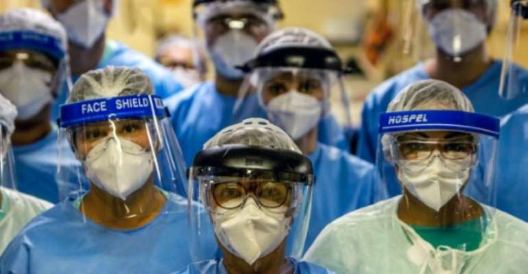 A group of doctors working with patients infected with the novel coronavirus COVID-19 wear face shields at the Intensive Care Unit of the Hospital de Clinicas in Porto Alegre, Brazil.  By Silvio AVILA (AFP)