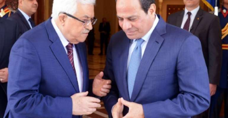 A handout picture provided by the Palestinian Authority's press office (PPO) shows Egyptian President Abdel Fattah al-Sisi (R) meeting with Palestinian leader Mahmud Abbas in the capital Cairo on May 9, 2016.  By THAER GHANAIM (PPO/AFP/File)