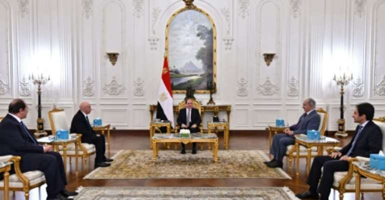 A handout picture released by the Egyptian Presidency on September 14, 2021, shows Egyptian President Abdel Fattah al-Sisi (C) meeting with Libyan military strongman Khalifa Haftar (2nd-R) and Libyan Parliament speaker Aguila Saleh (2nd-L) in Cairo.  By - (EGYPTIAN PRESIDENCY/AFP)