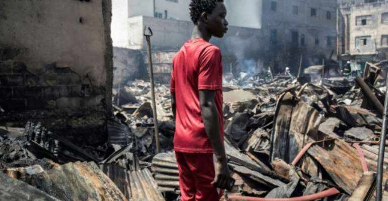 A huge blaze burnt the wood market to the ground in Senegal's Dakar.  By JOHN WESSELS (AFP)