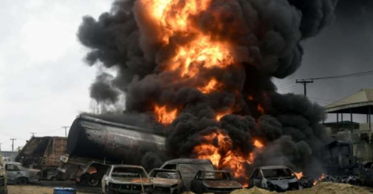 A huge fireball was sparked by vandals who broke open a state-run pipeline in order to steal petrol in the Ijegun area of the city on Thursday.  By PIUS UTOMI EKPEI (AFP/File)