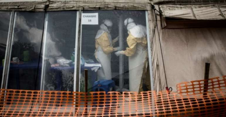 A judge said three of the suspects were thought to have fired shots in the April 19, 2019 attack on a doctor fighting Ebola in the Democratic Republic of Congo (Ebola treatment center pictured March 2019).  By JOHN WESSELS (AFP/File)