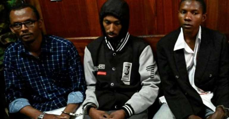 A Kenya court handed Hassan Aden Hassan, left, Mohamed Ali Abikar and Rashid Charles Mberesero long sentences for abetting the 2015 Garissa University attack.  By SIMON MAINA (AFP)